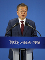 Moon returns home after historic summit