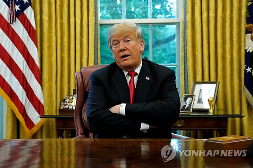 This Reuters photo shows President Donald Trump answering a reporter's qustion at the White House on Oct. 10, 2018 (Yonhap)