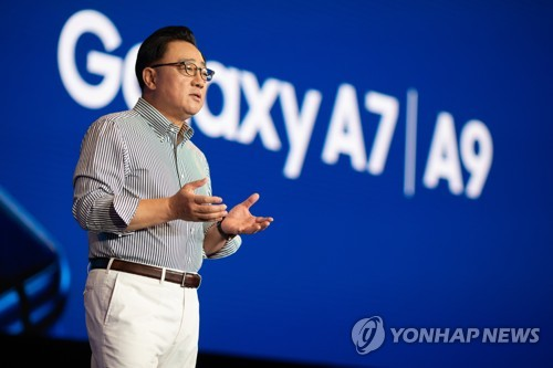 This photo provided by Samsung Electronics shows its President Koh Dong-jin, who heads the company's mobile business, introducing the Galaxy A9 smartphone, which is packed with four rear cameras, at an event in Malaysia on Oct. 11, 2018. (Yonhap)