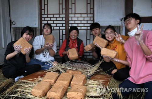 Making bricks of bean paste for soy sauce