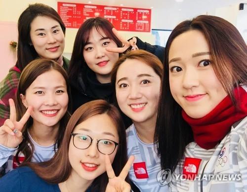 This file photo taken Feb. 27, 2018, shows the South Korean women's curling team at the 2018 PyeongChang Olympics taking a group photo at a cafe in Daegu. Clockwise from top left: head coach Kim Min-jung, Kim Cho-hee, Kim Yeong-mi, Kim Kyeong-ae, Kim Seon-yeong and Kim Eun-jung.