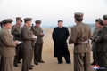 N.K. leader inspects testing of new tactical weapon
