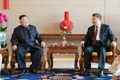 Líderes de Corea del Norte y China