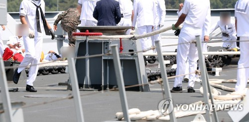(LEAD) One Navy officer dead, four injured in accident involving destroyer docked at port