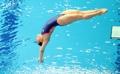Kim Su-ji compite en el salto de trampolín de 1 metro del campeonato mundial de la FINA
