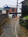 Firefighters pump water from yard on Jeju Island