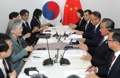 Cancilleres de Seúl y Pekín