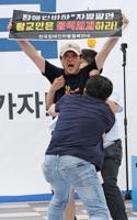 황교안 발언 중 일어난 장애인단체 기습시위