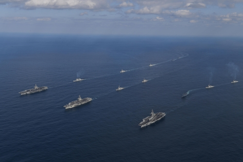 Three U.S. aircraft carriers steam in formation in the East Sea, leading South Korean and U.S. warships during the allies' joint naval exercise on Nov. 12, 2017, in this photo provided by South Korea's Navy. (Yonnap)