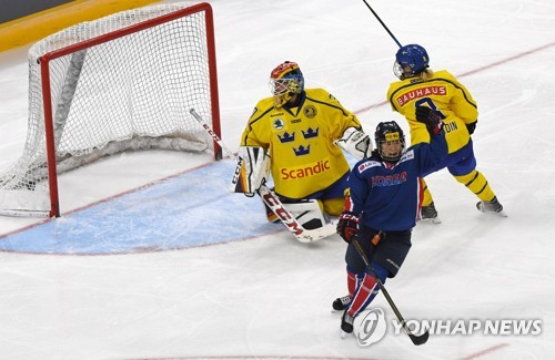 In this file photo, taken July 29, 2017, Park Jong-ah of South Korea (C) celebrates her goal against Sweden during the teams' friendly game at Gangneung Hockey Centre in Gangneung, Gangwon Province. (Yonhap)